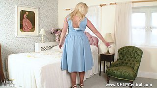 Busty buxom blonde Anna Joy toys pussy deep in retro garters and nylon stockings