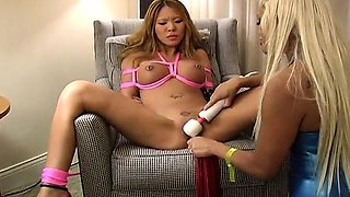 Smoking hot Asain babe is bound and vibrator stimulated
