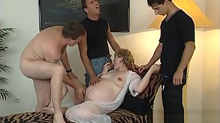 Pregnant babe getting fucked by three men