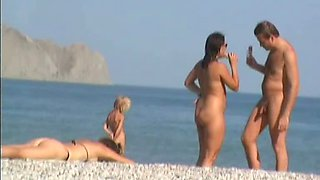Nudist beach voyeur video of a mature brunette with big tits