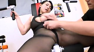Big breasted Oriental milf in nylons engages in hardcore sex