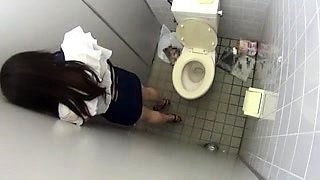 Slender Japanese beauty sucks and fucks in a public toilet