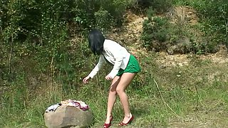 Watch raven haired nympho in red heels who is pissing outdoors