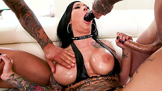 Oiled up whore in latex boots does a hard DP