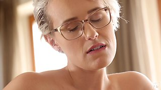 Sexy busty beauty in glasses Angel Wicky happily rides strong cock on top
