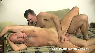 Two mature guys fuck on the couch