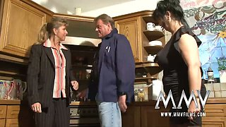 Two mature housewives and one kinky guy are having dirty sex in the kitchen