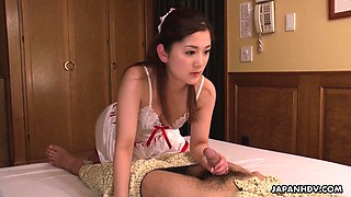 Pretty Japanese maid in uniform Anna Kimijima gives a blowjob to her patron