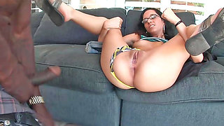 Nerdy babe Tia Cyrus tries on a huge black monster dick