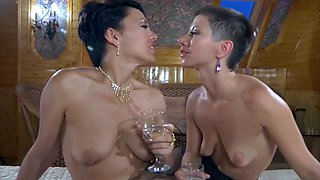Two short haired lesbians licking each other