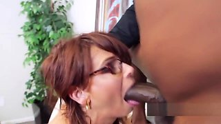 MILF in glasses is salivating from those fat boners