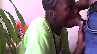 Horny black boy wraps his lips around a big white dick