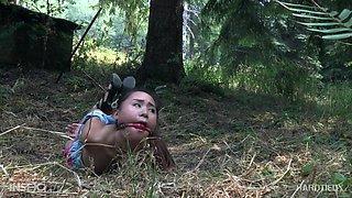 Forest hardcore bondage fetish scene with Asian babe Elle Voneva