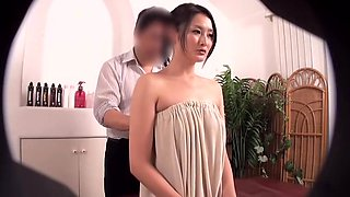 Oiled Asian darling prefers getting massaged by her friend
