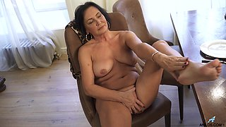 A bit plump housewife Olivia Westervelt gets nude and masturbates on the table