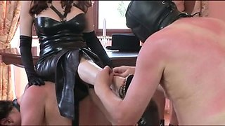 Older slut uses submissive males as her slaves
