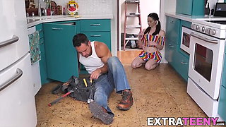 Small babe with big boobs seduces a plumber in the kitchen