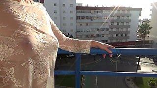 Transparent dress on a busy street