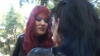 Hot red haired Dominatrix enjoys her big titted slave