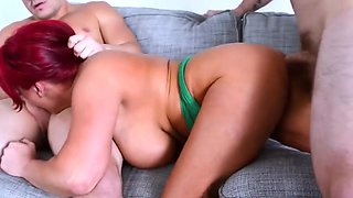 big tits redhead cougar gives a good DP to two dudes