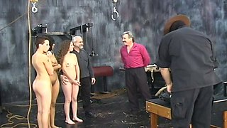 Several naughty sex-slaves are punished on the round table