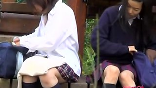 Two cute Asian babes sitting upskirt exposure