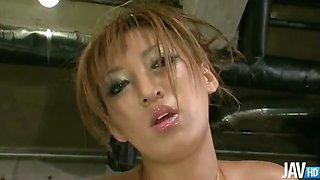 Japanese av model Hina Maeda in gold lame strips and teases