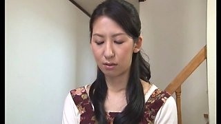 Japanese housewife gives the nerd his first handjob
