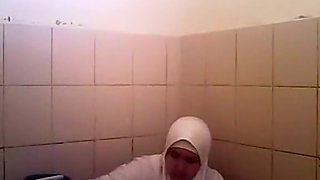 Arab woman goes pee in a public toilet