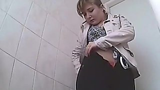 Chubby woman peeing in toilet