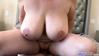 Voluptuous neighbor with big tits welcomes a younger man into her bedroom